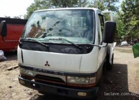 2 camiones Mitsubishi Canter 2003