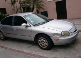 Ford Taurus 1996 gris nunca chocado