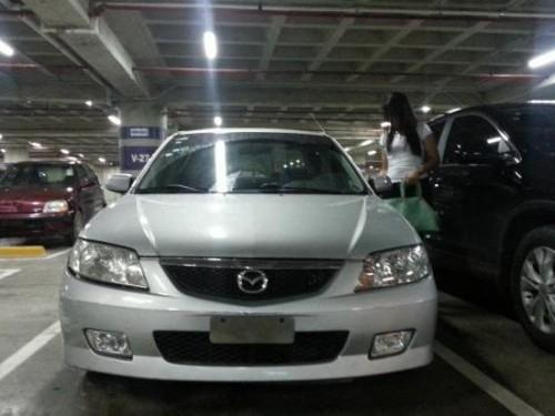 Mazda 323 2002 Gris , Santo Domingo - 149036