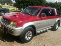 Mitsubishi L200 2002 roja