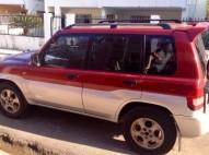 Mitsubishi montero 2002 io roja negociable