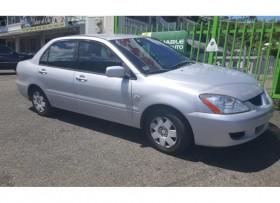 Mitsubishi lancer 2004 aut gris 3900