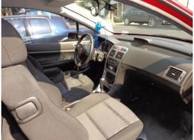 Peugeot 307 hatchback tres puertas color vino