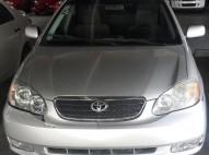 Toyota corolla 2004 EXi plateado en buenas condiciones