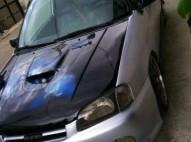 Toyota starlet 2000 Glanza Gris con negro