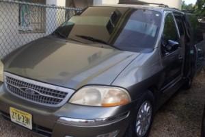ford windstar 235000 mil pesos 1999 gris